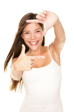 sexy pictures: Woman showing frame finger sign smiling cheerful and happy. Fresh energetic portrait of young beautiful Asian woman isolated on white background.