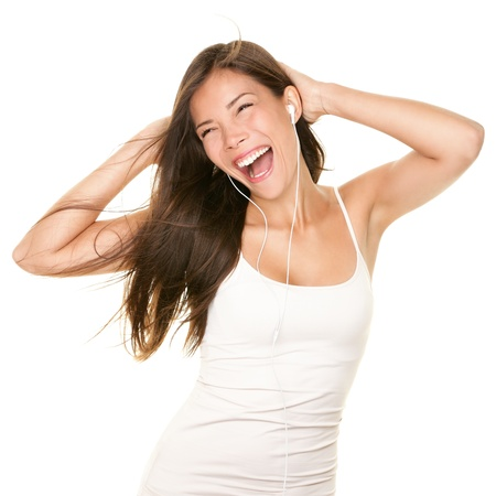 earbud: Music. Woman dancing with earbuds  headphones listening to music on mp3 player. Playful happy smiling young mixed race Asian Caucasian woman isolated on white background.