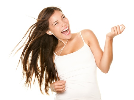 earphone: Woman dancing to music listening to mp3 player with earphones  earbuds. Energetic air guitar move by happy Asian  Caucasian dancer isolated on white background.