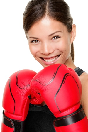 boxing training: Boxer woman. Boxing fitness woman smiling happy wearing red boxing gloves. Portrait of sporty fit Asian Caucasian model on white background.