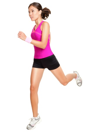 Running fitness woman isolated. Female runner in sporty pink fitness outfit jogging isolated on white background. Beautiful mixed race Asian Caucasian fitness model training.