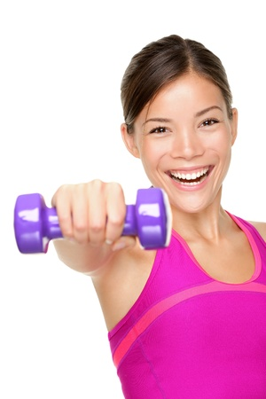 fitness woman. Fit fitness girl smiling happy lifting weights looking strength training shoulder muscles. Caucasian Asian fitness model isolated on white background.