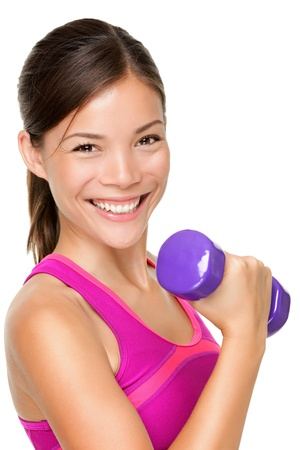 fitness model: Fitness sport girl smiling happy. Fitness woman lifting dumbbells strength training biceps doing curls. Mixed Caucasian and Asian fitness model portrait isolated on white background. Stock Photo