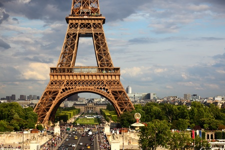 Eiffel Tower - Paris travel icon. Day with dramatic sky.