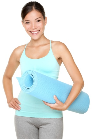 fitness model: exercise fitness woman ready for workout standing holding yoga mat isolated on white background. Sporty fit and fresh mixed race Chinese Asian  Caucasian female fitness model. Stock Photo