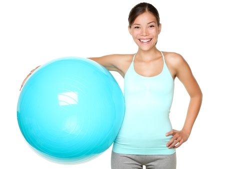Fitness exercise woman holding pilates ball ready for exercising. photo