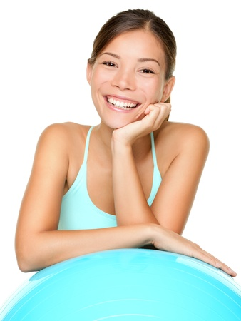 Fitness pilates woman smiling happy portrait isolated on white background. Healthy lifestyle image of beautiful young mixed race Asian / Caucasian female fitness model isolated on white background. Stock Photo - 10440644