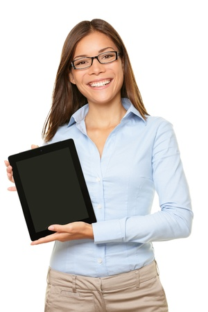 woman showing tablet computer screen smiling wearing glasses isolated on white background. Banco de Imagens
