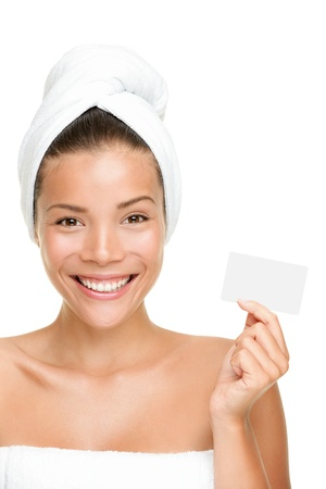 hair treatment: Spa woman showing business card smiling happy. Female beauty treatment concept with beautiful young mixed race Chinese Asian Caucasian woman model.