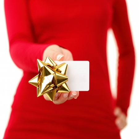 Gift card - closeup of woman showing sign card wearing red. Isolated on white background.
