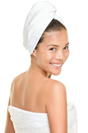 Spa beauty treatment woman wearing white towels. Happy smiling multi-racial asian caucasian female model isolated on white background. photo