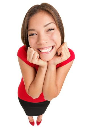 Funny cute excited woman isolated in full length. High angle fish eye like view of young female model in red top isolated on white background.
