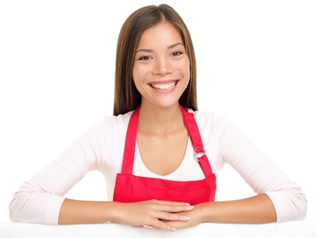apron woman sales assistant clerk smiling happy with arms on edge for sign or similar. Beautiful content and joyful female model isolated on white background photo