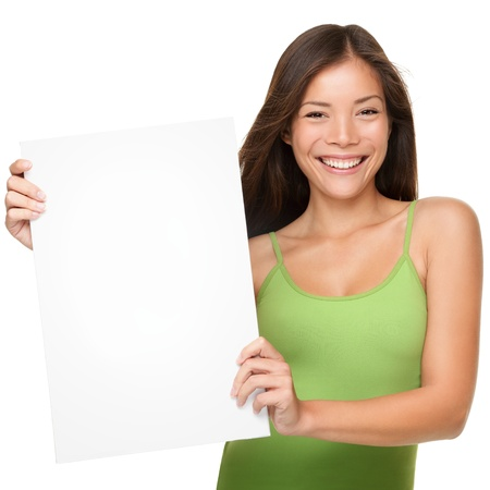 Showing sign woman. Woman showing empty blank paper sign board with copy space for text or design. Fresh and beautiful mixed race Chinese Asian / Caucasian female model in casual green tank top isolated on white background.