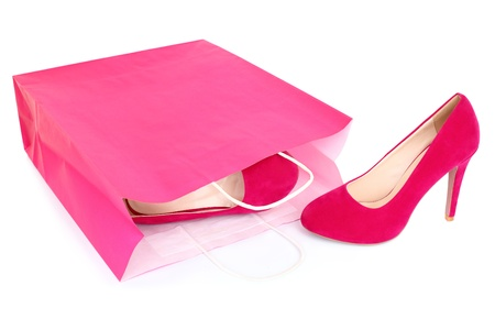 red bag: Shopping shoes isolated. Red  pink high heels shoes and shopping bag closeup isolated on white background.