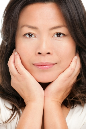 Middle aged asian woman beauty portrait. Closeup of mid age Chinese Asian female model. photo