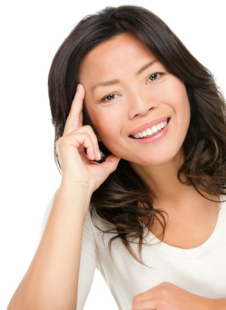 Asian woman. Middle aged chinese asian woman in her early 50s smiling happy. Isolated on white background.