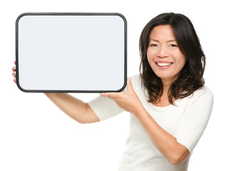 old poster: Asian middle aged woman showing whiteboard sign isolated on white background. Mature Asian Chinese mid age female adult in her early 50s smiling happy.