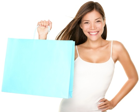 shoppers: Shopping bag woman. Beautiful smiling happy woman holding showing blue shopping bag isolated on white background. Fresh multiracial Asian Caucasian female model.