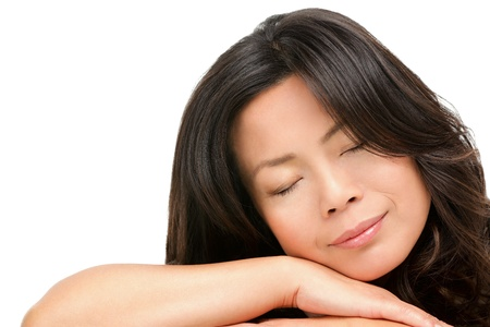 Sleeping mature middle aged Asian woman closeup portrait isolated on white background. Chinese Asian female mid age model.