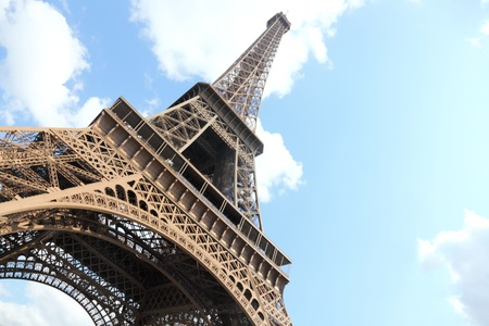 Eiffel Tower, Paris, France. Low angle, wide angle view, day time with blue sky.
