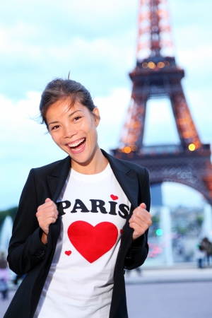 student travel: Paris Eiffel tower woman happy and excited in front of the Eiffeltower, Paris, France. Stock Photo