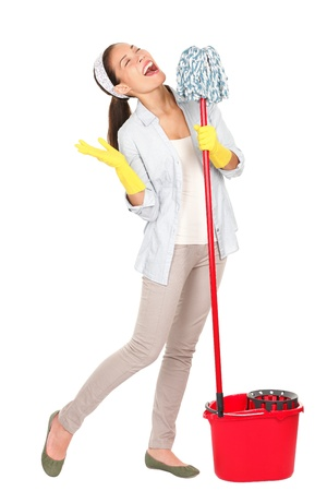 Spring cleaning woman singing fun using mop isolated on white background.