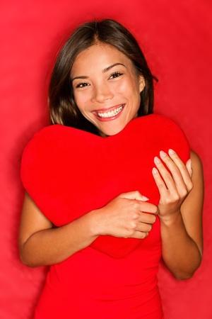 Love girl holding heart. photo