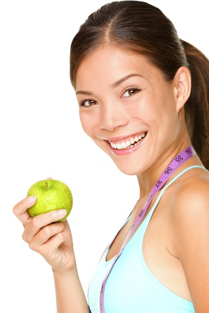 Healthy lifestyle. Fitness woman eating apple wearing measuring tape.  Banque d'images