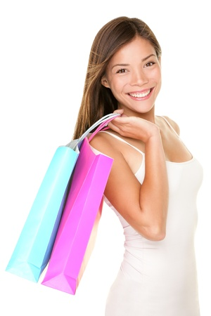 mixed race teen: Shopper girl holding shopping bags smiling happy and fresh.