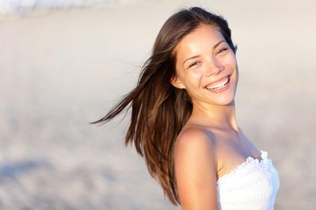 Asian woman on beach smiling happy.  Archivio Fotografico
