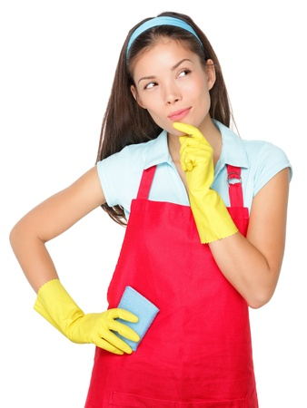 Cleaning lady thinking isolated on white background. Фото со стока