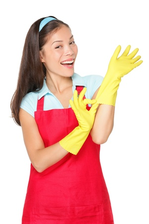 Cleaning lady getting spring cleaning ready putting on rubber gloves. Фото со стока