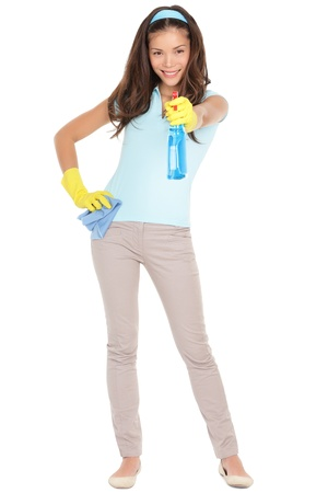 Spring cleaning woman pointing cleaning spray bottle shooting at camera.  Stock Photo