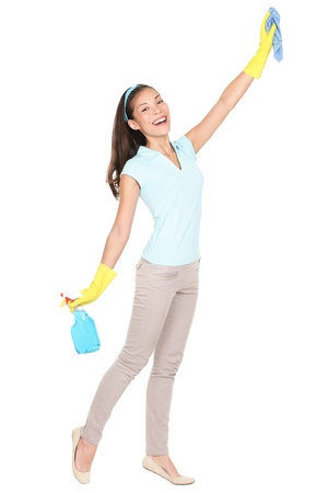 clean up: Woman cleaning scrubbing and polishing reaching and stretching with cleaning cloth and spray bottle.  Stock Photo