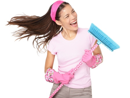 broom: Cleaning woman singing having fun during spring cleaning.