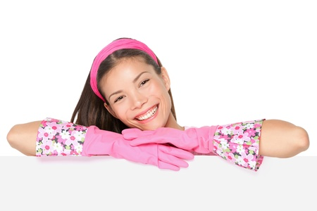 Cleaning woman showing blank sign billboard smiling happy  Spring cleaning concept  Cleaning lady holding blank empty paper sign placard  Cute funny image of cleaning woman wearing pink runbber gloves  Mixed ethnicity Caucasian   Chinese Asian female mode