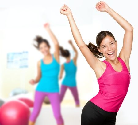 fitness trainer: Fitness dance class aerobics  Women dancing happy energetic in gym fitness class  Stock Photo