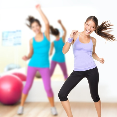 aerobic training: Fitness dance studio class. Dancing woman in gym during exercise dancer workout training with happy fresh energy. Stock Photo
