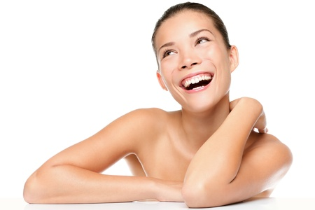 Skin care beauty woman laughing smiling happy and cheerful. Asian / Caucasian mixed race female beauty model isolated on white background. photo