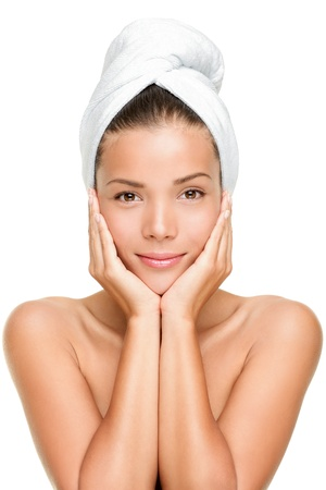 Spa skin care beauty woman wearing hair towel after beauty treatment. Beautiful multiracial young woman with perfect skin isolated on white background. Mixed race Caucasian  Asian female beauty model looking at camera. photo