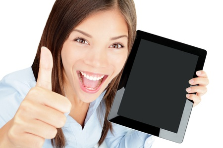Tablet computer woman happy excited showing touch pad screen and thumbs up  Beautiful winning mixed race Asian Chinese   Caucasian female model  Standard-Bild