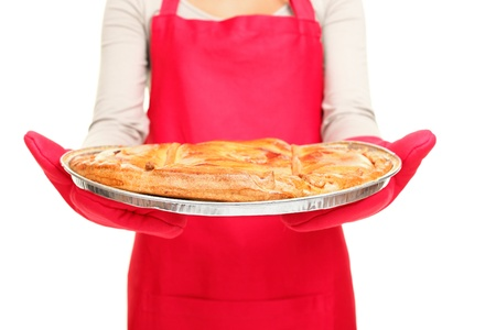 woman eating cake: Apple pie  Woman holding showing apple pie  Closeup of woman baking in red isolated on white background Stock Photo