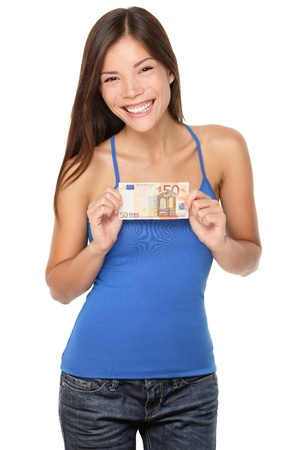 Euro bill woman smiling happy showing 50 euro money note isolated on white background. Beautiful fresh young mixed race Asian / Caucasian girl in her twenties. Stockfoto
