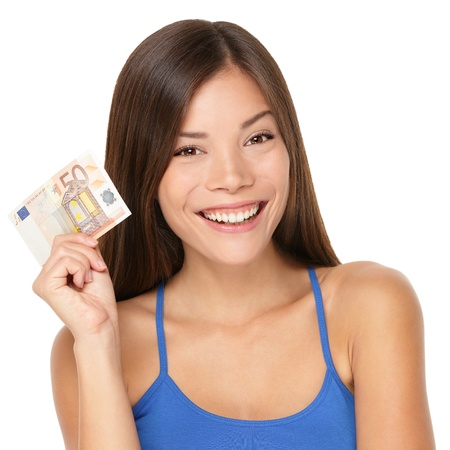 Woman holding euro money note. Pretty young model showing 50 euro bill. Closeup of gorgeous multi-ethnic Asian / Caucasian woman model isolated on white background. Archivio Fotografico