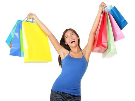 donna entusiasta: Lo shopping donna felice eccitato e allegro nella beatitudine gioiosa. Shopper in possesso di molti sacchetti colorati isolato su sfondo bianco in studio. Euforico bella razza mista caucasica  asiatica modello cinese femminile. Archivio Fotografico