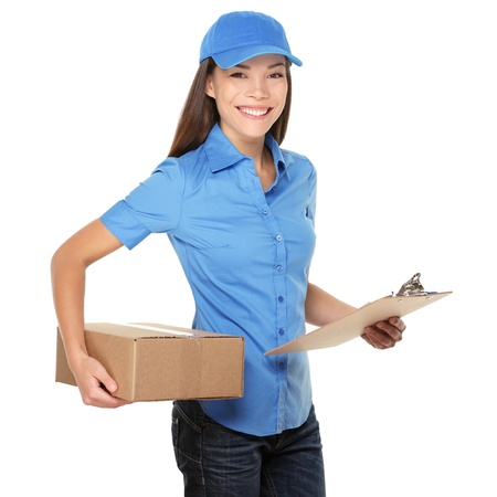 courier: Delivery person delivering packages holding clipboard and package smiling happy in blue uniform. Beautiful young mixed race Caucasian  Chinese Asian female professional courier isolated on white background. Stock Photo