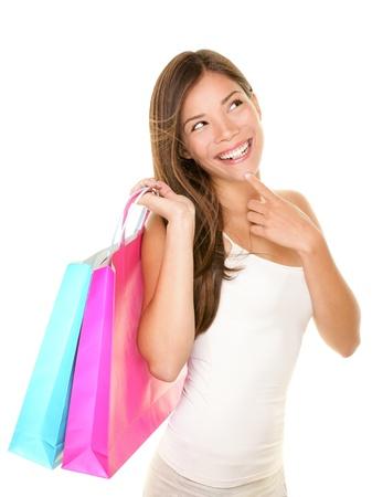 Winkelen vrouw denken te kijken naar kopie lachend fris en blij Stockfoto