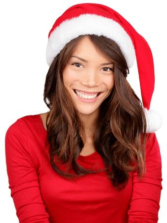 wearing santa hat: Christmas girl wearing santa hat  Portrait of Asian woman smiling happy on white background