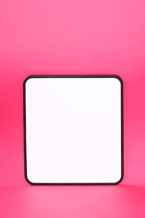 Whiteboard sign on pink background with copyspace. Archivio Fotografico